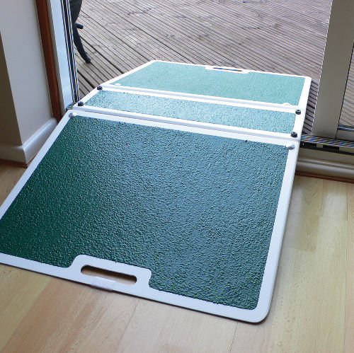 Folding Threshold Ramp For Wheelchairs And Scooters